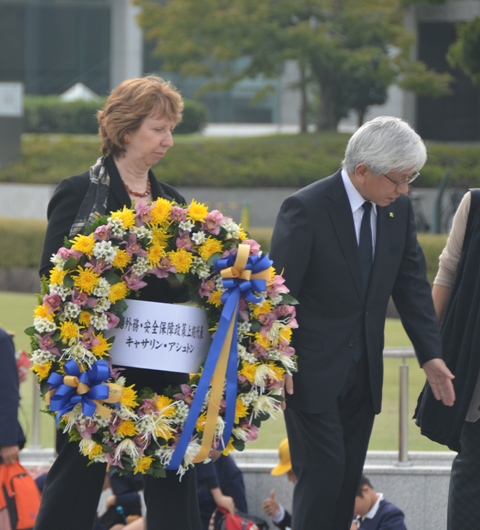 Ms. Ashton holding a wreath